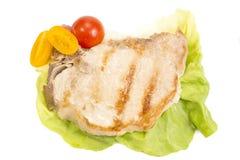 在白色隔绝的猪肉牛排 免版税库存图片