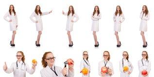 在白色隔绝的相当女性医生 免版税库存照片