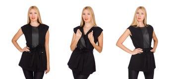 在白色隔绝的紧的黑裤子的俏丽的妇女 免版税图库摄影