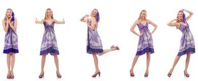 在白色隔绝的紫色礼服的美女 库存图片