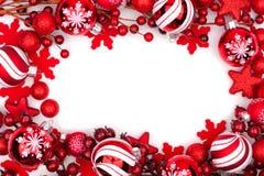 在白色隔绝的红色圣诞节装饰品框架 免版税库存图片