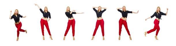 在白色隔绝的红色裤子的妇女 免版税库存图片