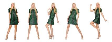 在白色隔绝的绿色礼服的少妇 库存图片