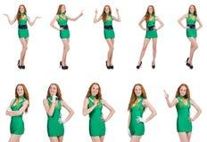 在白色隔绝的绿色礼服的年轻性感的女孩 免版税库存照片