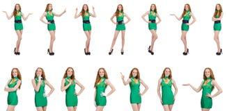 在白色隔绝的绿色礼服的年轻性感的女孩 免版税库存图片