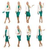 在白色隔绝的绿色礼服的相当少妇 免版税库存照片