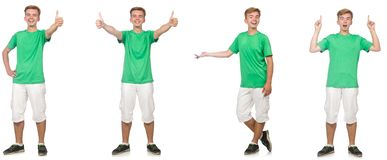 在白色隔绝的绿色T恤杉的年轻男孩 库存图片