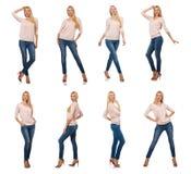 在白色隔绝的蓝色牛仔裤的俏丽的妇女 库存图片