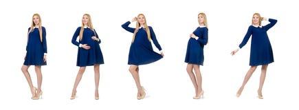 在白色隔绝的蓝色礼服的美丽的孕妇 库存图片