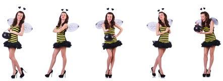 在白色隔绝的蜂服装的年轻女人 图库摄影