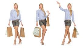 在白色隔绝的购物以后的少妇 免版税库存图片