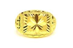 在白色隔绝的金下垂有浮雕的贝壳花梢圆环首饰 免版税库存照片