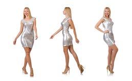 在白色隔绝的银色礼服的少妇 库存图片