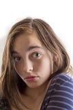 在白色隔绝的一个十几岁的女孩的画象 库存图片