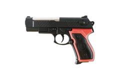 在白色隔绝的一个塑料手枪玩具 免版税库存照片