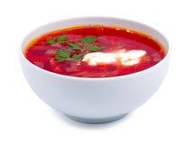 在白色隔绝的一个白色碗的热的罗宋汤 免版税库存图片