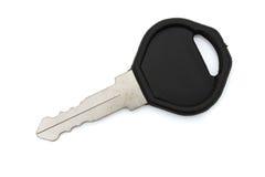 在白色隔绝的一把黑钥匙的特写镜头 库存照片