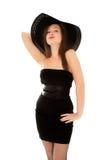 在白色隔绝的一点黑礼服的美丽的妇女 库存照片