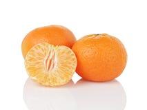 在白色隔绝的三个成熟蜜桔 库存照片