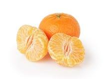 在白色隔绝的三个成熟蜜桔 图库摄影