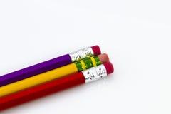 在白色隔绝的三支木锋利的铅笔 库存照片