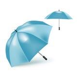 在白色隔绝的两把蓝色伞 免版税库存照片