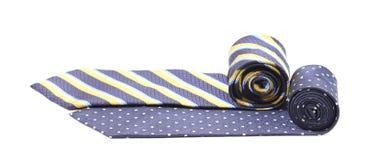 在白色隔绝的两条滚动的领带 免版税库存照片