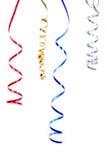 在白色隔绝的五彩纸屑蜒蜒丝带 库存图片