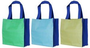 在白色隔绝的五颜六色的棉花袋子 免版税库存图片
