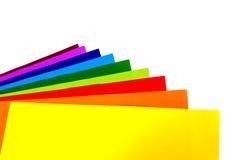 在白色隔绝的五颜六色的纸 免版税库存图片