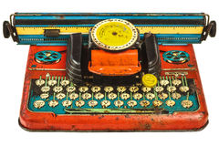 在白色隔绝的五颜六色的葡萄酒玩具打字机 免版税库存图片