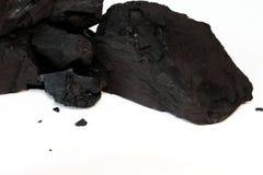 在白色隔绝的亚烟煤的煤炭 免版税图库摄影