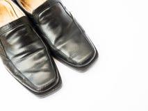 在白色隔绝的人皮鞋 免版税库存图片