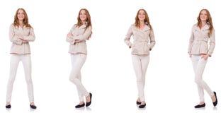 在白色隔绝的冬天衣物的愉快的妇女 库存图片