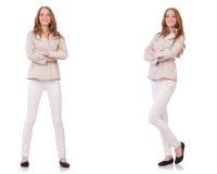 在白色隔绝的冬天衣物的愉快的妇女 免版税库存照片