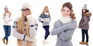 在白色隔绝的冬天衣裳的五个少妇 库存图片