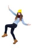在白色隔绝的冬天衣裳的滑稽的十几岁的女孩跳舞 免版税库存图片