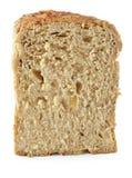 在白色隔绝的切片,包括的裁减路线上添面包 库存图片