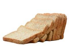 在白色隔绝的切的全麦面包 免版税图库摄影