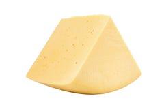 在白色隔绝的切达干酪区段 库存照片