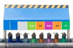 在白色隔绝的加油站的分开的汽油箱 库存照片