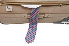 从在白色隔绝的半开手提箱的男性领带 免版税库存照片