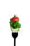 在白色隔绝的叉子的凉拌生菜 免版税库存照片