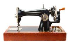 在白色隔绝的古色古香的缝纫机 免版税图库摄影