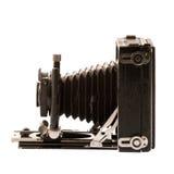 在白色隔绝的古色古香的老照片照相机 库存图片