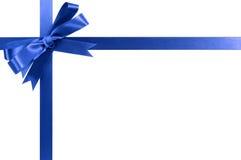 在白色隔绝的品蓝礼物丝带弓水平的壁角边界 免版税库存图片