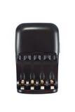 在白色隔绝的四个电池的黑蓄电池充电器 免版税库存图片