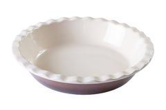 在白色隔绝的圆烘烤盘空 水平的特写镜头 免版税库存图片