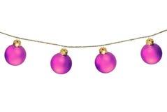 在白色隔绝的圣诞节紫色球 免版税库存照片
