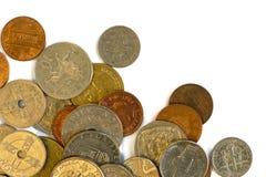 在白色隔绝的多个国家硬币  库存照片